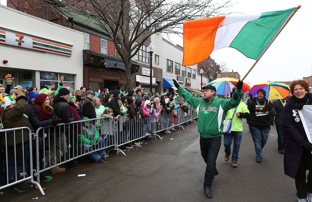 (Boston, MA - 3/15/15) Fast Freddy Murphy carries an Irish flag as he marches with Boston Pride during the St. Patrick's Day Parade in South Boston, Sunday, March 15, 2015. Staff photo by Angela Rowlings.