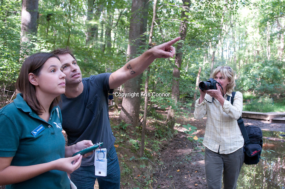 "Director Zack Snyder(R) with Sarah Krizek(L) look at group of birds during a visit to promote the new Warner Brothers' movie ""Legend of the Guardians: The Owls of Ga'Hoole,"" at the Audubon Naturalist Society Wildlife Sanctury in Chevy Chase, Md on September 14, 2010. Photo by Kris Connor"