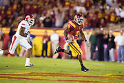 University of Southern California Trojan running back Reggie Bush out runs a Arkansas Razorback defender during a 70 to 17 win over the Razorbacks on September 17, 2005 at Los Angeles Memorial Coliseum in Los Angeles, California..Mandatory Credit: Wesley Hitt/Icon SMI