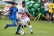 Team USA defender Armando Avila (3) tries to avoid a tackle from Team Guatemala midfielder Jarod Martinez (17) during a CONCACAF boys under-15 championship soccer game, Monday, Aug. 5, 2019, in Bradenton, Fla. The USA defeated Guatemala  2-0 (Kim Hukari/Image of Sport)