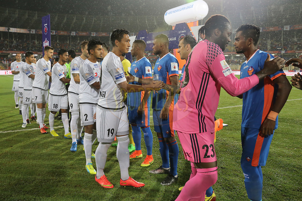 Players shake hand during match 8 of the Indian Super League (ISL) season 3 between FC Goa and FC Pune City held at the Fatorda Stadium in Goa, India on the 8th October 2016.<br /> <br /> Photo by Faheem Hussain / ISL/ SPORTZPICS