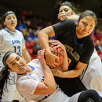 031015  Adron Gardner/Independent<br /> <br /> St. Michael's Horsemen Alexandra Groenewold (24), left, and Kirtland Central Bronco Krystal Sheeka (33) lock together for a jump ball during the New Mexico state basketball tournament at The Pit in Albuquerque Tuesday.