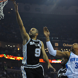 Jan 18, 2010; New Orleans, LA, USA; San Antonio Spurs guard Tony Parker (9) shoots past New Orleans Hornets forward David West (30) during the first half at the New Orleans Arena. Mandatory Credit: Derick E. Hingle-US PRESSWIRE