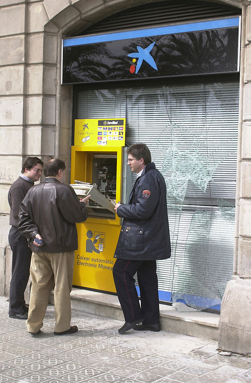 Broken cash point in Barcelona after anti-globalisation demonstration.