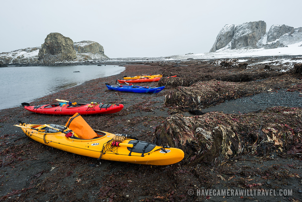 Sea kayaks are pulled up on the beach of Livingston Island in the South Shetland Islands in Antarctica.