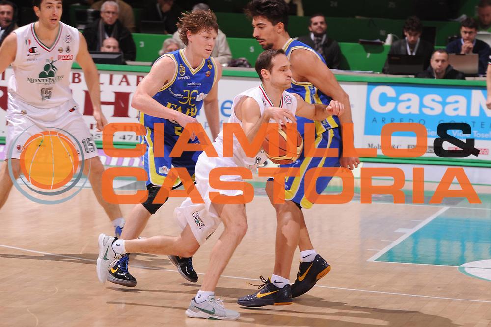 DESCRIZIONE : Siena Lega Basket A 2011-12  Montepaschi Siena Fabi Shoes Montegranaro<br /> GIOCATORE : Igor Rakocevic<br /> CATEGORIA : blocco<br /> SQUADRA : Montepaschi Siena<br /> EVENTO : Campionato Lega A 2011-2012 <br /> GARA : Montepaschi Siena Fabi Shoes Montegranaro<br /> DATA : 15/01/2012<br /> SPORT : Pallacanestro  <br /> AUTORE : Agenzia Ciamillo-Castoria/ GiulioCiamillo<br /> Galleria : Lega Basket A 2011-2012  <br /> Fotonotizia : Siena Lega Basket A 2011-12 Montepaschi Siena Fabi Shoes Montegranaro<br /> Predefinita :