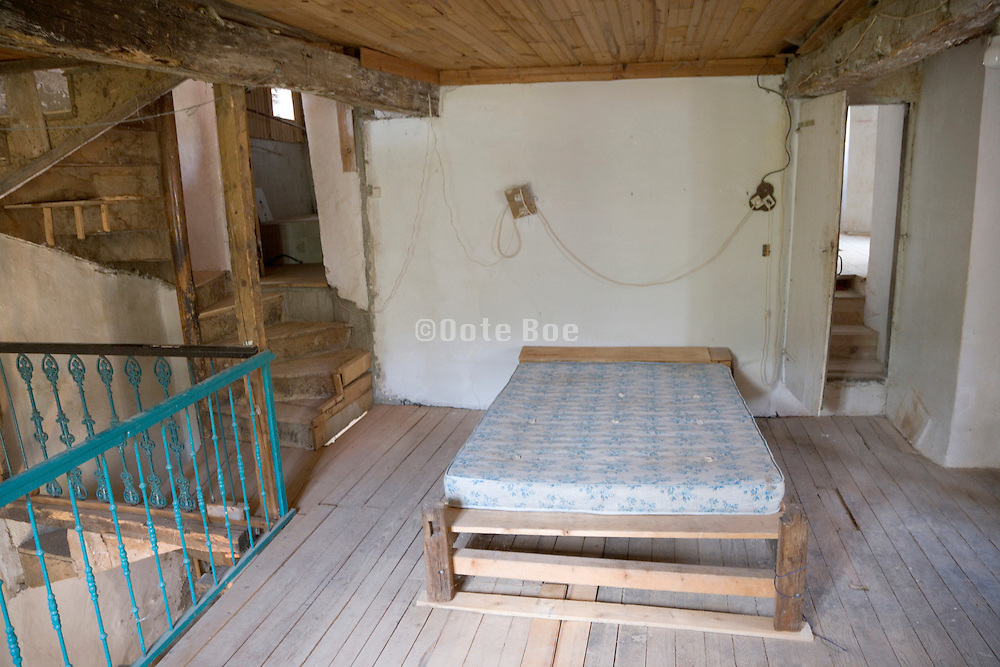 improvised bedroom in an old house under renovation