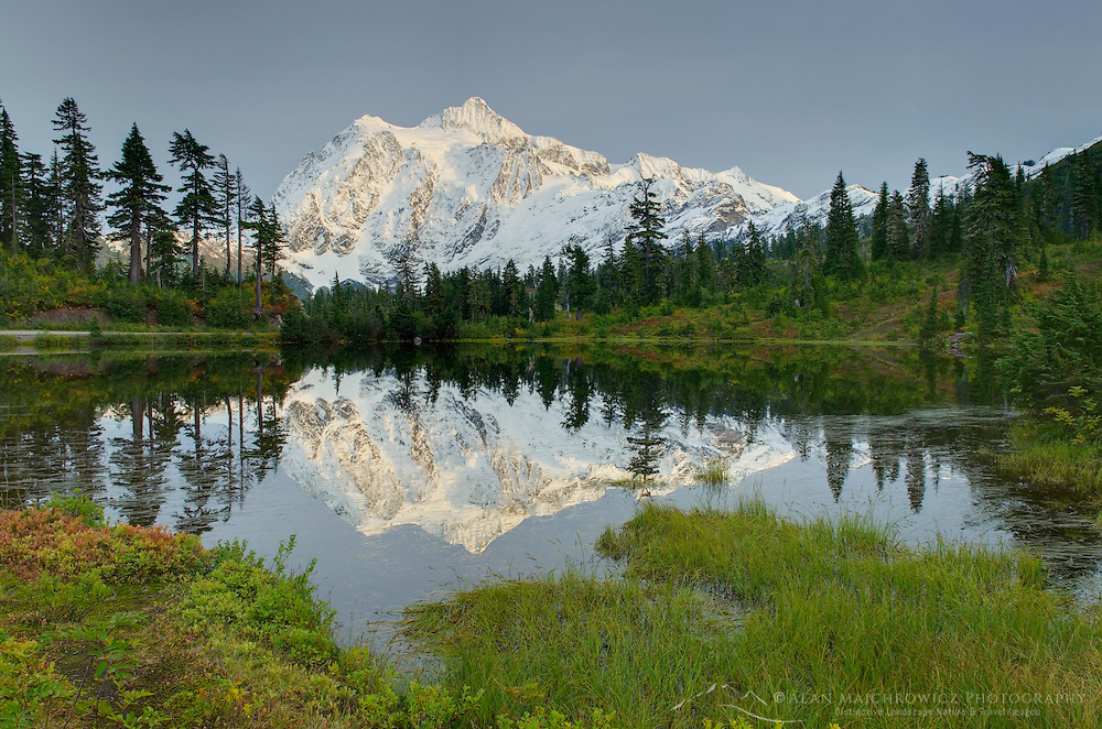 Mount Shuksan 9131 ft / 2783 m reflected in Picture Lake on a fall evening, North Cascades Washington