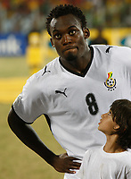 Photo: Steve Bond/Richard Lane Photography.<br />Ghana v Namibia. Africa Cup of Nations. 24/01/2008. Michael Essien and his mascot exchange words