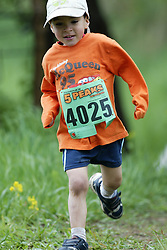 "(Kingston, Ontario---16/05/09) ""Benen Macewen running in the kids race at the 2009 Salomon 5 Peaks Trail Running series Race held in Kingston, Ontario as part of the Eastern Ontario/Quebec division. ""  Copyright photograph Sean Burges / Mundo Sport Images, 2009. www.mundosportimages.com / www.msievents.com."