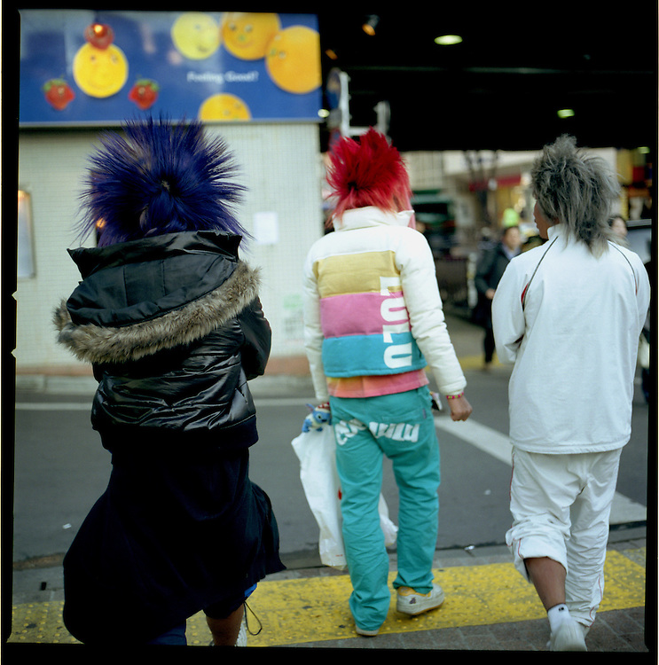 Gal-O boys with spiked, painted hairstyles leaving Shibuya, Tokyo, Japan.