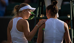 July 1, 2019 - London, GREAT BRITAIN - Caroline Wozniacki of Denmark & Sara Sorribes Tormo of Spain at the net after Sorribes Tormo is forced to retire from their first round match at the 2019 Wimbledon Championships Grand Slam Tennis Tournament (Credit Image: © AFP7 via ZUMA Wire)