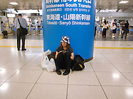 August 22, 2016 - Tokyo, Japan: At Tokyo Station, the major rail hub of the city, tens of thousands of travelers were delayed or stranded throughout the day due to Typhoon Mindulle hitting Tokyo. This typhoon, the ninth of this season, hit greater Tokyo and the outlying Kanto Plain area with the eye making landfall in neighboring Chiba Prefecture at around 12:30 p.m. Packing sustained winds of 126 kph (78 mph) and gusts as high as 180 kph (112 mph), Mindulle was the equivalent of a category 1 hurricane. It caused flooding as well as delays and cancelations to rail service including commuter lines, long distance express trains and the Shinkansen bullet train. In addition to rail disruption,s 244 flights were canceled at Tokyo's Haneda Airport. (Torin Boyd/Polaris).