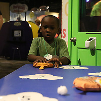 Jalyn Osborne, 5, plays the Cloud 9 game at Healthworks 9th Birthday celebration Saturday