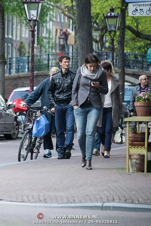 NLD/Amsterdam/20120515 - Voetbal international Khalid Boulahrouz op de grachten van Amsterdam,
