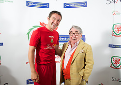 CARDIFF, WALES - Tuesday, August 14, 2012: Llanelli AFC's Antonio Corbisiero with Ronnie Corbett, the sporting ambassador ot Corbett Sport, at the launch the 2012/2013 Welsh Premier League at the St. David's Hotel. (Pic by David Rawcliffe/Propaganda)