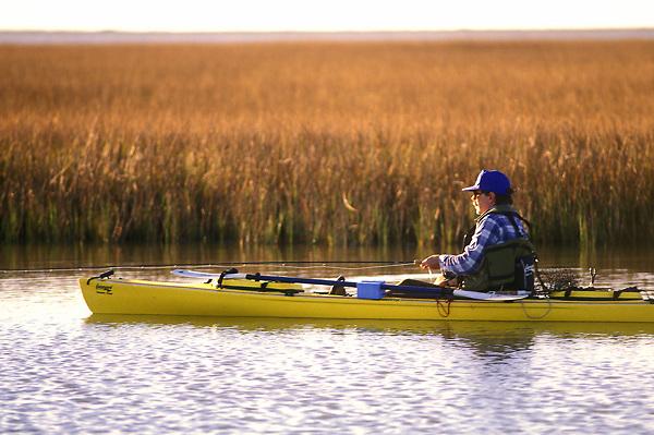 Stock photo of a man sitting in his kayak fishing
