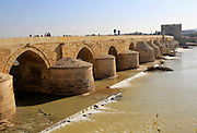 Roman bridge spanning river Rio Guadalquivir, Cordoba, Spain