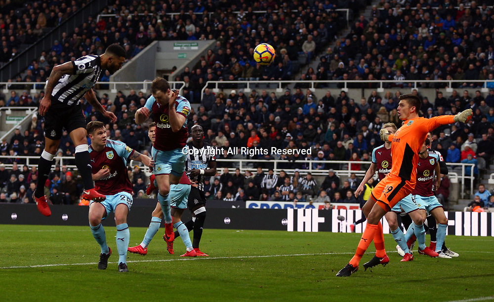 31st January 2018, St James Park, Newcastle upon Tyne, England; EPL Premier League football, Newcastle United Burnley; Jamaal Lascelles of Newcastle United heads them into a 1-0 lead in the 65th minute past Nick Pope of Burnley