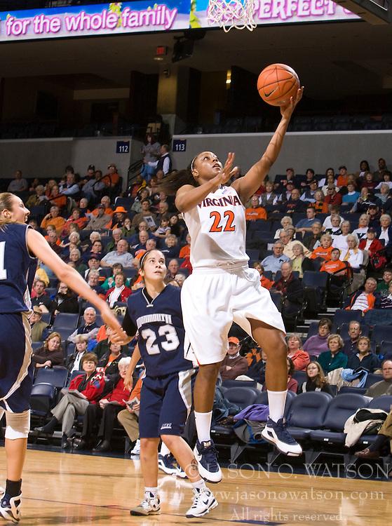 Virginia forward Monica Wright (22) shoots an uncontested jump shot against MU.  The Virginia Cavaliers women's basketball team defeated the Monmouth Hawks 71-45 at the John Paul Jones Arena in Charlottesville, VA on December 18, 2008.