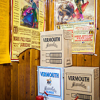 Old bullfight posters and vermouth boxes in an old tavern, Burgo de Osma, Soria, Spain