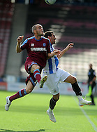 Picture by Graham Crowther/Focus Images Ltd. 07763140036.10/9/11 .Gary Roberts of Huddersfield feels the challange from Dave Raven of Tranmere during the Npower League 1 game at the Galpharm Stadium, Huddersfield.