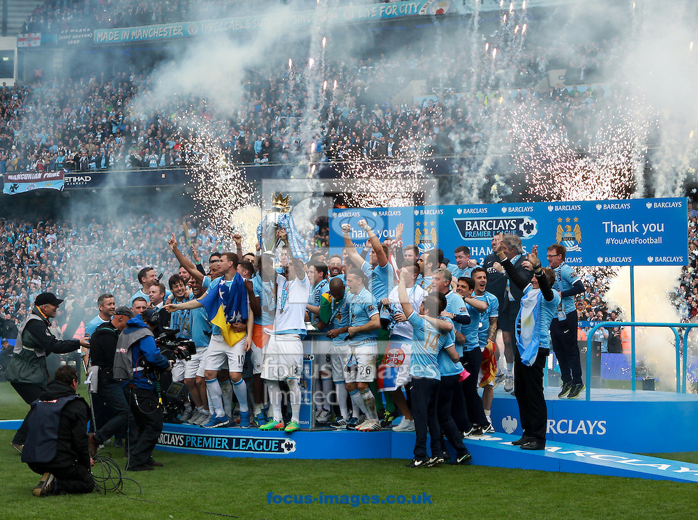 The Manchester City squad celebrate winning the Barclays Premier League at the Etihad Stadium, Manchester<br /> Picture by John Rainford/Focus Images Ltd +44 7506 538356<br /> 11/05/2014