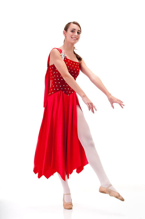Young girl practicing classic dance in ballerina dress.