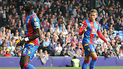 Dwight Gayle and Yannick Bolasie discuss options during the Barclays Premier League match between Crystal Palace and West Bromwich Albion at Selhurst Park, London, England on 3 October 2015. Photo by Michael Hulf.