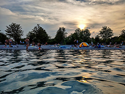 August 1, 2018 - Munich, Bavaria, Germany - Germans escape the above-normal heatwave temperatures at the Langwiedersee (Lake Langwied) in Munich, where temperatures have reached the mid to high-30s (90s F) several days in a row with no relief in sight for several more days. (Credit Image: © Sachelle Babbar via ZUMA Wire)