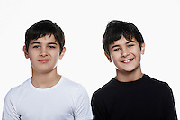 Studio portrait of twin boys (13-15)