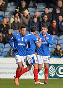 Portsmouth players celebrate Portsmouth striker Marc McNulty's opening goal during the Sky Bet League 2 match between Portsmouth and Cambridge United at Fratton Park, Portsmouth, England on 27 February 2016. Photo by Adam Rivers.