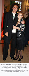 Musician BRIAN MAY and actress ANITA DOBSON at a reception in London on 7th July 2004.PWZ 10