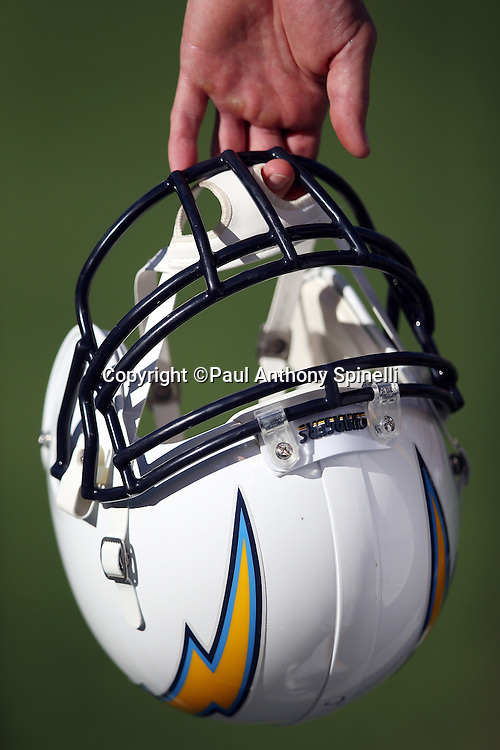 A San Diego Chargers player holds his helmet on the sideline during the 2015 NFL preseason football game against the Seattle Seahawks on Saturday, Aug. 29, 2015 in San Diego. The Seahawks won the game 16-15. (©Paul Anthony Spinelli)