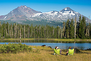 USA, Oregon, Lane  County, Willamette National Forest,Scott Lake, two women sitting in chairs