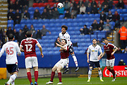 Bolton Wanderers Derik Osede (15) outjumps Northampton Towns John-Joe O'Toole (21) during the EFL Sky Bet League 1 match between Bolton Wanderers and Northampton Town at the Macron Stadium, Bolton, England on 18 March 2017. Photo by Craig Galloway.