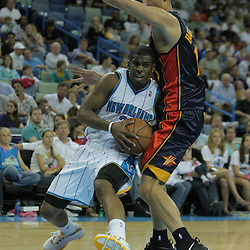 05 October 2008:  New Orleans Hornets guard Chris Paul (3) draws a foul from Golden State Warriors center Andris Biedrins (15) during a NBA preseason game between the Golden State Warriors and the New Orleans Hornets at at the New Orleans Arena in New Orleans, LA..