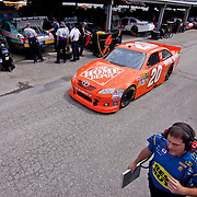 Joey Logano #20 pulls into of the NASCAR Sprint Cup Series garage Friday May. 13, 2011 during NASCAR Sprint Cup Series practice race at Dover International Speedway in Dover Delaware.