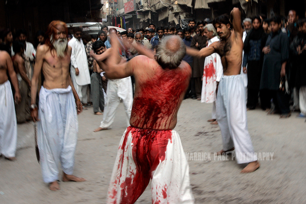 Shia Muslims flagellate themselves during Ashura rituals on January 30, 2007, in Lahore, Pakistan. Millions of Muslims worldwide observe Ashura during the month of Muharram to mourn the death of the Prophet Mohammed's grandson Immam Hussain. Some Shia participate in self-flagelation to punish themselves for failing to protect the prophet's grandson. Many Shia, however, see this act as unnecessary. During the month of Muharram, many Shia's give generously to the poor and spend time in prayer. Security is stepped up every year throughout the country during Ashura due to ongoing violence between Shia and Sunni Muslim groups who frequently attack during opposing religious observances. (Photo by Warrick Page)