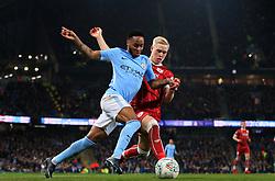 Hordur Magnusson of Bristol City tackles Raheem Sterling of Manchester City  - Mandatory by-line: Matt McNulty/JMP - 09/01/2018 - FOOTBALL - Etihad Stadium - Manchester, England - Manchester City v Bristol City - Carabao Cup Semi-Final First Leg