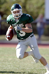 07 October 2006: Titan Eric Esch. &#xD;The Titans of Illinois Wesleyan University started off strong with a touchdown on the 2nd play from scrimmage in the game.  The Titans led most of the way, but failed to maintain the lead in the 4th quarter giving up the decision of this CCIW conference game to the Red Men of Carthage by a score of 31 - 28. Action was at Wilder Field on the campus of Illinois Wesleyan University in Bloomington Illinois.<br />