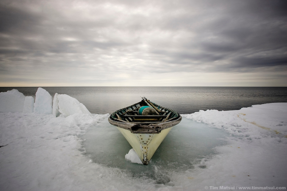 May 3, 2008 -- Kivalina, AK, U.S.A..A ready whaling boat sits on the edge of the pack ice as native Inupiat wait to spot a beluga or bowhead whale some two miles out on the melting pack ice and 12 miles from the native village of Kivalina, Alaska. Kivalina is suing 20 oil companies for property damage related to global warming; the ocean pack ice forms later and melts earlier, leaving the town vulnerable to erosive winter storms and endangering their traditional subsistence lifestyle. (Photo by Tim Matsui)
