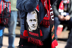A general view of a Manchester United Scarf with manager Jose Mourinho's face on before the Premier League match at Old Trafford, Manchester.