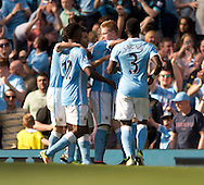 Manchester City players congratulate their team-mate Kevin De Bruyne (2nd right) after he scored his team's 2nd goal to make it 2-1 during the Barclays Premier League match at the Etihad Stadium, Manchester<br /> Picture by Russell Hart/Focus Images Ltd 07791 688 420<br /> 08/05/2016