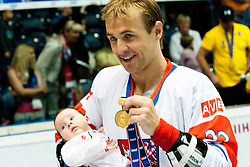 Jiri Polansky of Czech Republic with his baby at IIHF In-Line Hockey World Championships 2011 Top Division Gold medal game between National teams of Czech republic and USA on June 25, 2011, in Pardubice, Czech Republic. (Photo by Matic Klansek Velej / Sportida)