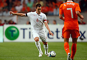 John Terry (ENG) and Robin van Persie (NED) in action during the International Friendly between Netherlands and England at the Amsterdam Arena on August 12, 2009 in Amsterdam, Netherlands.