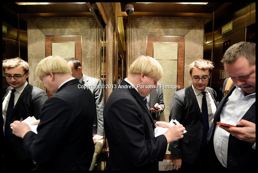 The London Mayor Boris Johnson writting his speech in the lift as he goe's to the London Luxury Quarter event in Beijing, China, on Day 2 of The Mayor's 6 day trip to China, Monday, 14th October 2013. Picture by Andrew Parsons / i-Images