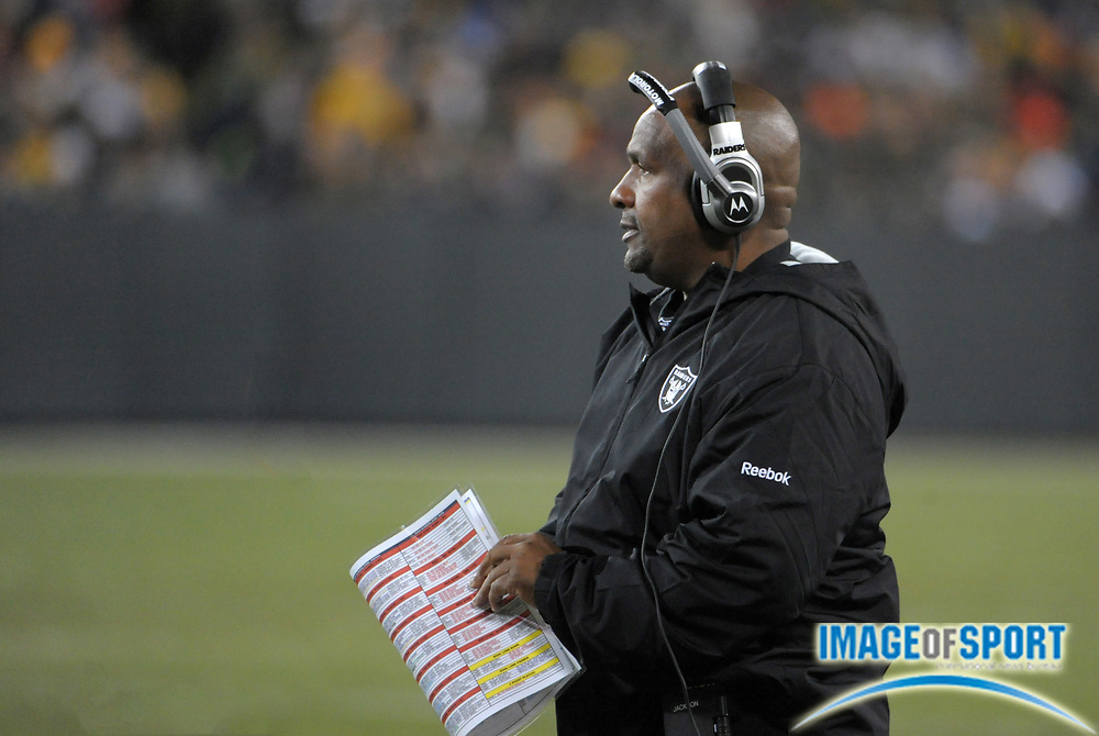 Dec 11, 2011; Green Bay, WI, USA; Oakland Raiders coach Hue Jackson watches on the sidelines in the second quarter against the Green Bay Packers at Lambeau Field.