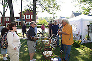 (from left) Donna and Ed Peescy of Lebanon talk with Fred Jacobs of Lima during Art on the Lawn, the 28th Annual Fine Arts & Crafts Festival at Mills Lawn Elementary School in Yellow Springs, Saturday, August 13, 2011.