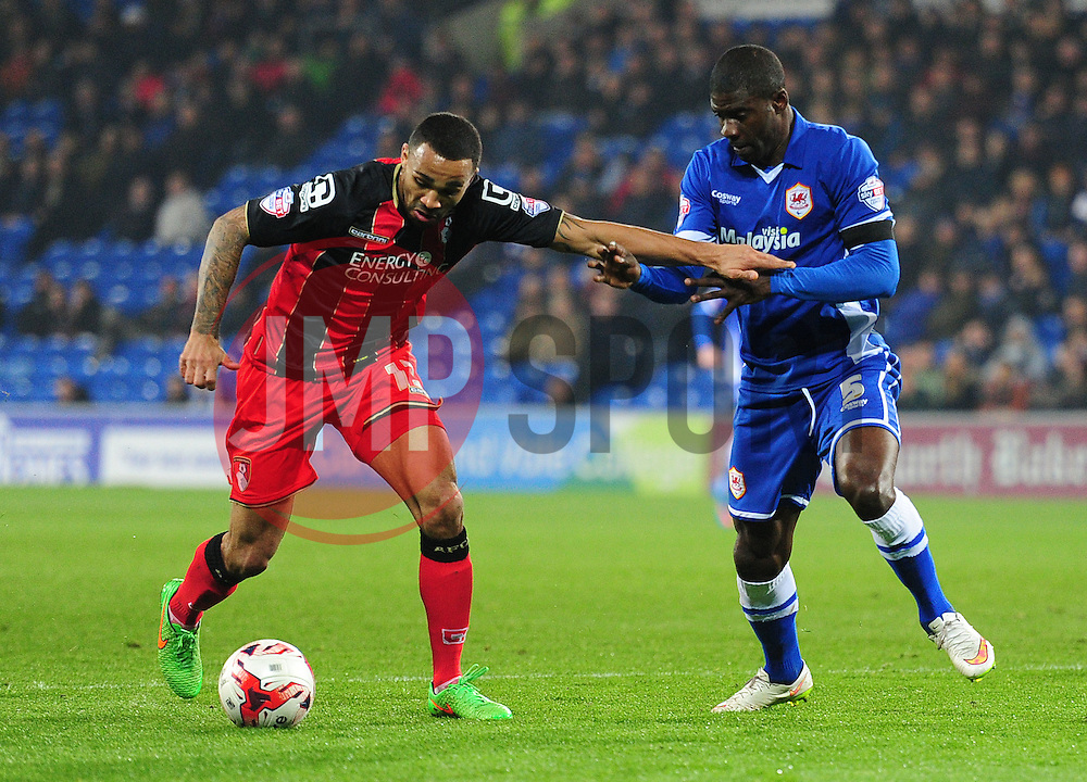 Bournemouth's Callum Wilson attacks under pressure from Cardiff City's Bruno Ecuele Manga - Photo mandatory by-line: Alex James/JMP - Mobile: 07966 386802 - 17/03/2015 - SPORT - Football - Cardiff - Cardiff City Stadium - Cardiff City v AFC Bournemouth - Sky Bet Championship